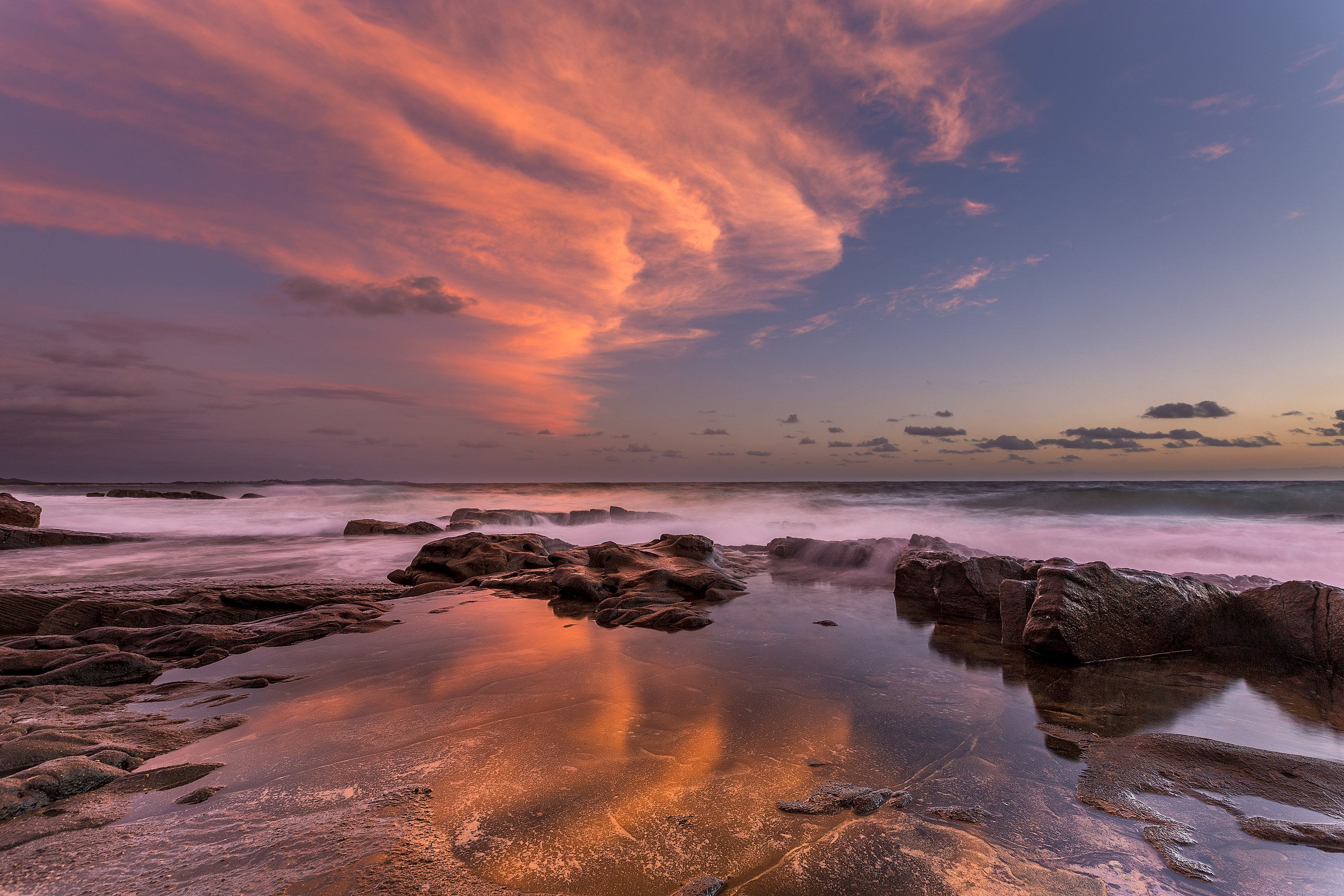 Amazing clouds reflected in rock-pools at Point Arkwright on the Sunshine Coast